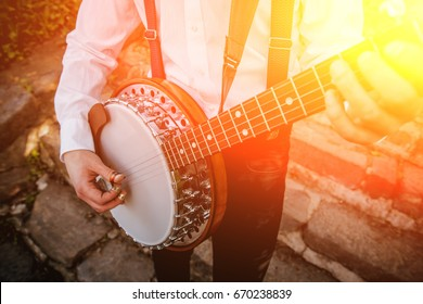 View of musician playing banjo at the street