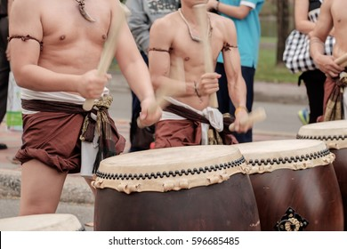 View of musician playing big drum on the street. Movement.
