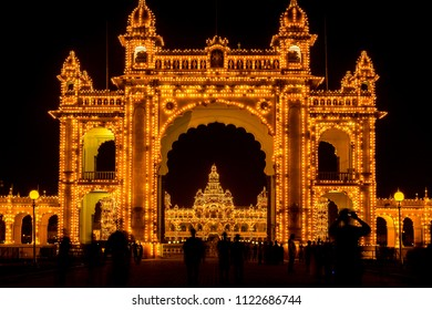 "View of Mysore Palace entrance iluminated at night, also known as Ambavilas Palace, Karnataka, India. ""East Gate""."