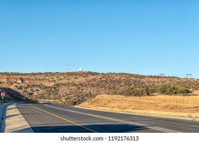 A view of the N8-road to the west of Bloemfontein in the Free State Province of South Africa. A weather radar system and cellphone tower is visible