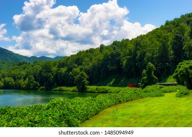 View of Nantahala Lake as seen from one of many passenger cars on a train traveling through the Nantahala National Forest.