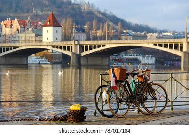 View from Prague´s naplavka with old bikes in foreground - Shutterstock ID 787017184