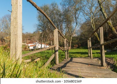 View of a narrow pedestrian wooden bridge in Oliveira de Azemeis, Aveiro - Portugal.