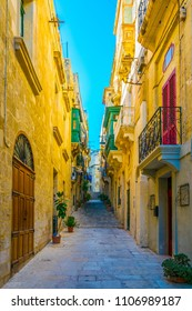 View of a narrow street in the historical center of Birgu, Malta