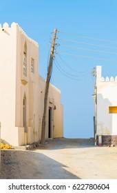 View of a narrow street of the Omani city Al Ayjah.