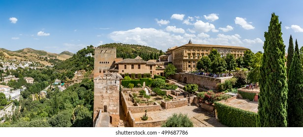 View of the Nasrid Palaces (Palacios Nazaries) and the Palace of Charles V in Alhambra, Granada on a beautiful day, Spain