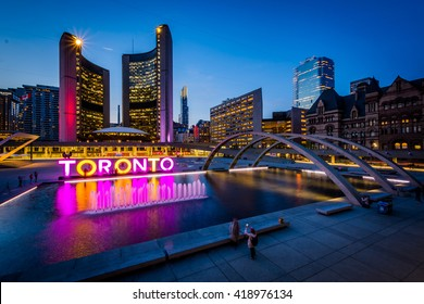 View of Nathan Phillips Square and Toronto Sign in downtown at twilight, in Toronto, Ontario.