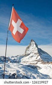 View of the national flag of Switzerland with the Matterhorn in the background