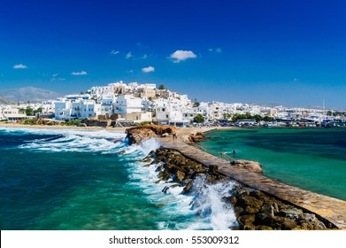 View of Naxos town and breaking waves, Cyclades archipelago, Greece