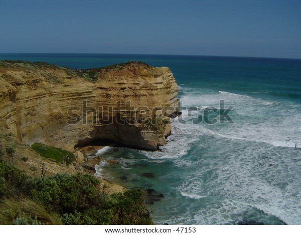 A view near the 12 apostles at the Great Ocean road. The great Ocean waters constantly hitting upon this battered hill side