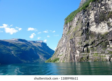 View of nearby mountains and waterfalls from the Geirangerfjord in Norway