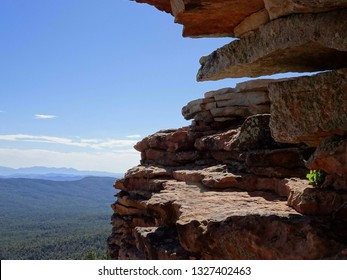 View of nearby rock formations and distant mountains from the top of the rim; Mogollon Rim in Apache-Sitgreaves National Forest in Arizona