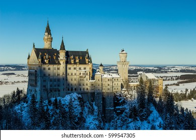 View of Neuschwanstein Castle in winter from Queen Mary's Bridge with snow