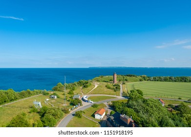 View from the new lighthouse at Cape Arkona to the Baltic Sea and the former Marinepeilturm tower with the tourist train Cape-Arkona-rail in Putgarten on the island of Rügen