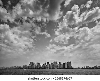View of New York City from Ocean with Dramatic Clouds shot in Black and White