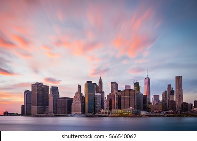 View of the New York Lower Manhattan buildings with colorful clouds above