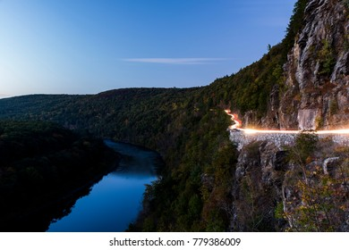 A view of New York State Route 97, the Upper Delaware Scenic Byway, as it passes alongside the Delaware River and Hawks Nest near Port Jarvis in Orange County, New York.