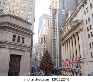 View of New York Stock exchange facade and Christmas tree. New York, NY , USA - December 30, 2018