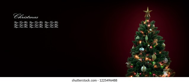 view of nice decorated christmas tree on deep red back