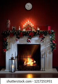 view of nice white christmas decorated fireplace  with candles in it