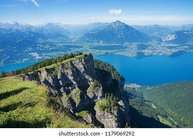 view from niederhorn mountain to lake thunersee, bernese oberland swiss alps landscape