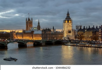 View at night on London's southern part with cityscape, Westminster Abbey, Big Ben, Houses of Parliament and Thames river.