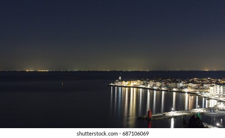 View of the night Piran from the height and the Adriatic Sea