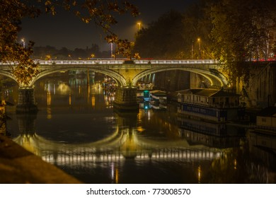The view of the night Rome and the river Tiber, ships on the water
