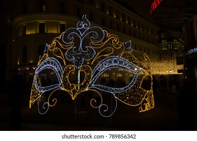 view to Nikolskaya street, Moscow, Russia - December 28th 2017 - Christmas and New Year decorations and theater mask installation/ constructions with colorful lights for holidays. editorial.