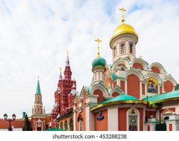 View of Nikolskaya Tower, State Historical Museum and Kazan Cathedral on sunny day in Moscow, Russia