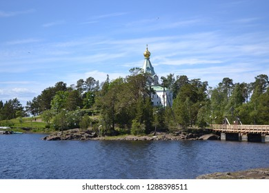View of the Nikolsky skete on Valaam Island. Beautiful nature and blue sky.