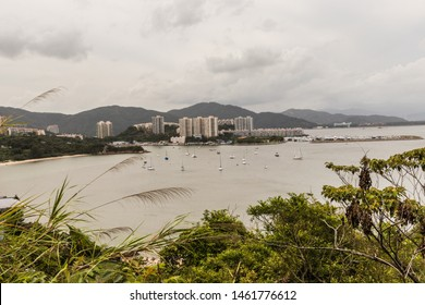 A view of Nim Shue Wan from Lantau Island on a cloudy day