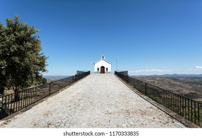 View of the nineteenth century Chapel of St Gabriel with a gable truncated by the bell tower, portal in perfect arch and two rectangular crevices, near the historic village of Castelo Melhor, Portugal