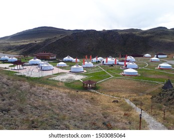 View of a nomadic camp in the background of a beautiful mountain landscape. Aldyn-Bulak touristic camp in Tyva, Russia, Asia.