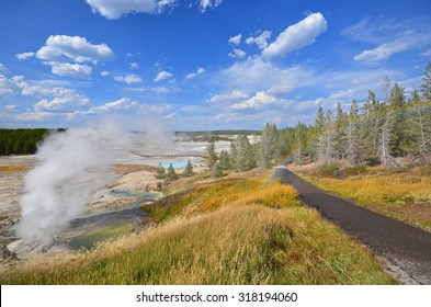 view of Norris Geyser Basin and rainbow in Yellowstone National Park, Wyoming, USA