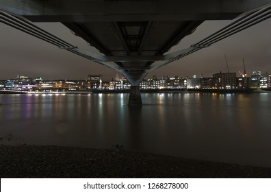 View of the North Bank of the Thames from under The Millenium Bridge at Night