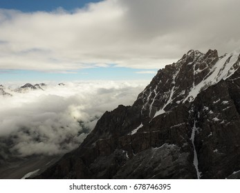 The view of north face of mount Dykh Tau in morning sunlight with a clear summit,