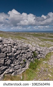 The view north, northwest over the walled path to Dun Aonghasa (Dun Aengus) looking across karst landscape.  Aran Islands, County Galway, Ireland.