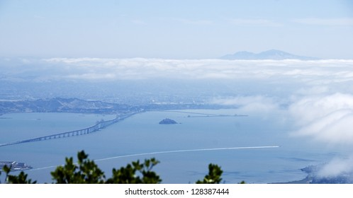 View of the north part of San Francisco Bay from the top of Mount Tamalpias in Marin County, with Mt Diablo visible above clouds on the horizon.