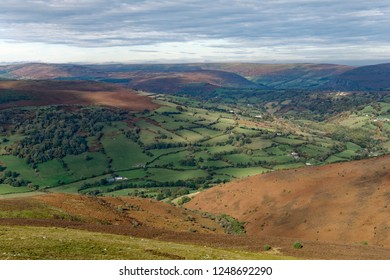 View North from summit of Sugar Loaf up the Vale of Ewyas with Partrishow Hill (left), Hatterrall Hill (right) and Black Darren in the distance. Abergavenny, Monmouthshire, Wales