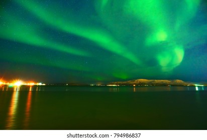 View of the northern light from the beachside in Reykjavik, Iceland.