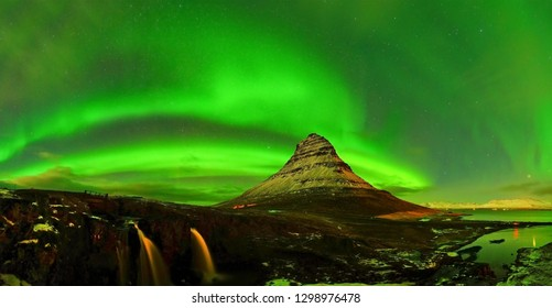 View of the northern light at night at Kirkjufell Mountain in Iceland.