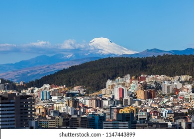 View of the northern part of the city of Quito with the Cayambe volcano in the background on a summer day