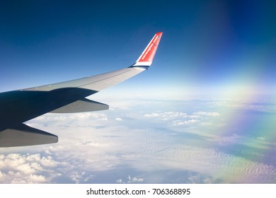 View from Norwegian airplane window with blue sky and white clouds. 08.07.2017 Palma de Mallorca, Spain