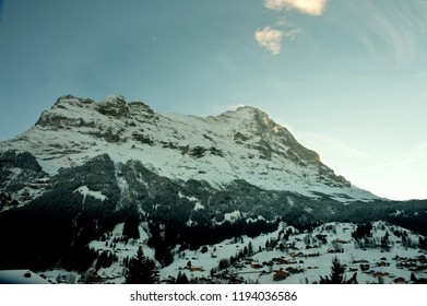 View to the nothern side of Eiger peak from Grindelwald valley in Swiss Alps on the sunset in winter.