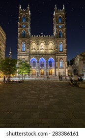 A view of the Notre-Dame Basilica in Montreal at night with copy space
