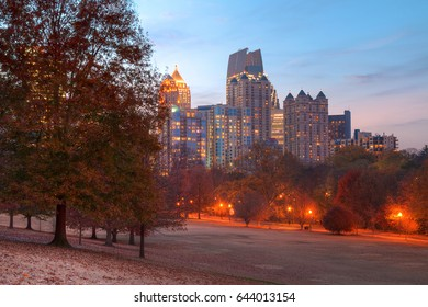 View of the Oak Hill in the Piedmont Park and Midtown Atlanta behind it in autumn twilight, USA