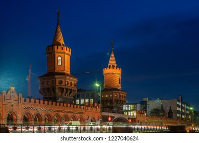 View of the Oberbaumbruecke and light trails  in a cold Autumn night in Berlin