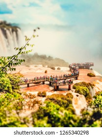 Close view of observation deck and bridges for tourists of the Cataratas water falls under blue sky, rainbow and a water mist at the Foz do Iguassu park - Brazil.