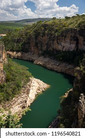 View from the observation deck of Furnas Canyons of the green water curved river on the bottom of the canyon. This is a famous tourist destination located in Capitolio, Minas Gerais / Brazil.